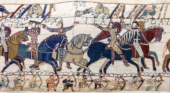 Guillaume soulève son heaume pour montrer à ses soldats qu'il n'est pas mort.